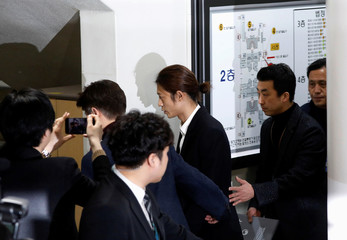 South Korean singer Jung Joon-young arrives at a court to attend a hearing for reviewing the prosecution's detention warrant at the Seoul Central District Court in Seoul