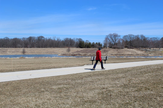 Woman walking on a path at Independence Grove in Libertyville, Illinois