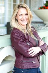 Portrait of a confident woman smiling outside.
