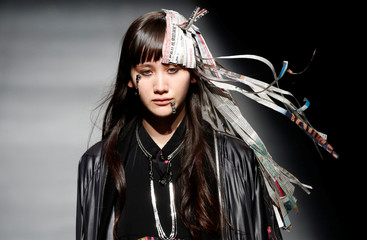 A model shows creations of ACUOD by CHANU during Amazon Fashion Week TOKYO in Tokyo