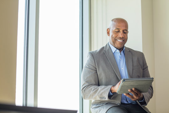 Mature African American man working on a tablet.