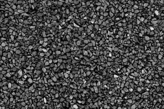 Black (gray) small crushed stones background texture