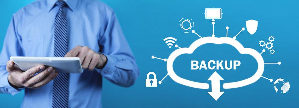 Man using tablet. Data Backup. Cloud Download. Internet, Technology