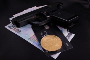 Euro money Bank card gold coin gun on black leather