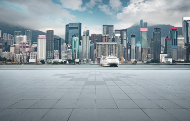 Empty concrete cement floor with sea and cityscape skyline , morning scene .