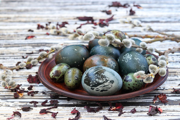 Easter eggs on a plate, painted with tea from the petals of a Sudanese rose or hibiscus