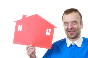 Man holding red house model