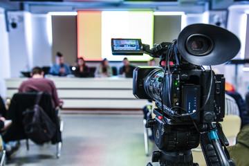 press conference tv camera