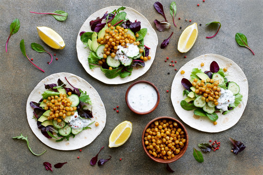 Vegan Tortilla Chickpea Avocado Salad Cucumber and Yogurt Sauce. Healthy clean eating food concept. Flat lay ingredient