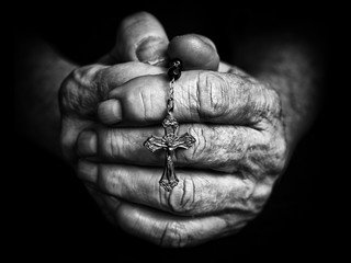 Rosary in praying hands