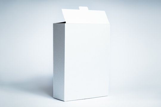 White generic box, studio shot. Blank carton food package, front view on white background