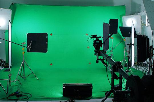 Green screen in studio with lighting equipments