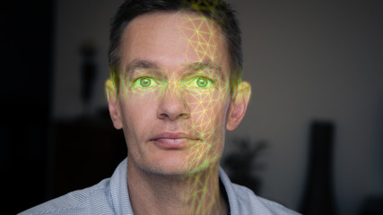 Facial recognition scanning a person's face