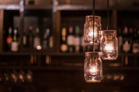 Vintage DIY light bulb in jars hanging at the bar night club