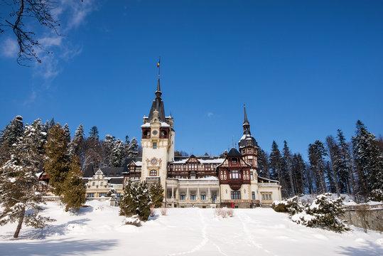 Peles castle in Romania. Beautiful, royal castle in snowy, white winter.