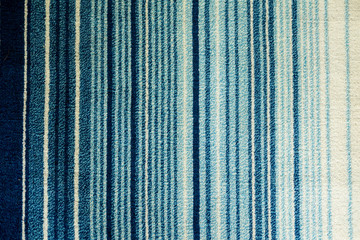 Texture of textile rug with striped pattern of white and blue