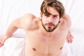 Picture showing young man stretching in bed. Man stretching in bed. Man morning bed.