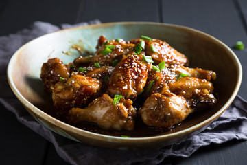 Teriyaki chicken wings with sesame and green onions