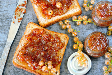 Toast with homemade currant jam. Freshly made jam from white currant. White currant. Useful sweets. Delicious croutons with white-currant jam.