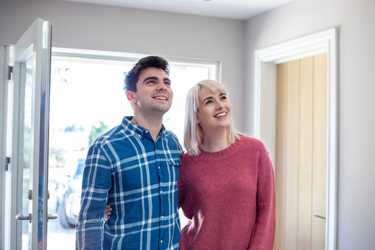 Young Couple Looking Around New Home To Rent Or Buy Together