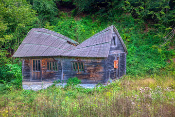 abandoned wooden hovel with broken roof