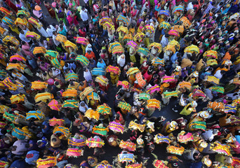 Devotees take part in a procession during the religious festival of Panguni Uthiram celebrated in honour of the Hindu god Muruga in Ahmedabad