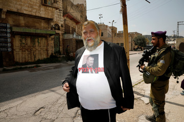 Benzi Gopstein from the Jewish Power party, wears a shirt bearing a picture of Attorney-General Avichai Mandelblit as he is dressed-up in costume during celebrations marking the Jewish holiday of Purim, in the Israeli-occupied West Bank city of Hebron