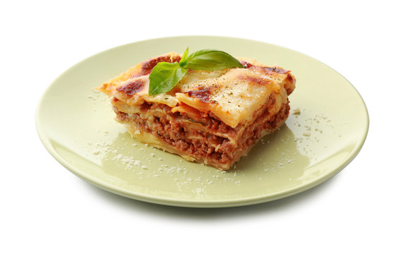 Plate with tasty baked lasagna on white background