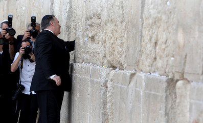 U.S. Secretary of State Mike Pompeo touches the stones of the Western Wall during a visit together with Israeli Prime Minister Benjamin Netanyahu,  and U.S. Ambassador to Israel David Friedman, to the site in Jerusalem's Old City