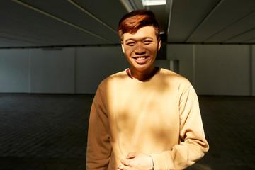 Positive Asian young man