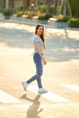 Pretty woman crossing road