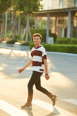 Cheerful man walking outdoors