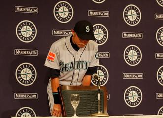 Seattle Mariners right fielder Ichiro Suzuki leaves a news conference in Tokyo
