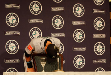 Seattle Mariners right fielder Ichiro Suzuki bows as he leaves a news conference in Tokyo