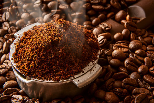 fragrant ground coffee poured into the holder