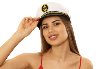 Close up studio portrait of a gorgeous sexy pin up sailor woman looking to the camera seductively wearing a cap isolated. Beautiful young sailor girl posing sensually. Sexuality, seduction, pin up