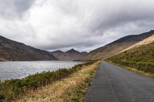 Road along a mountain lake