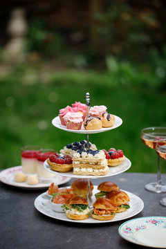 Afternoon tea with mini brioche canapes and selection of sweets