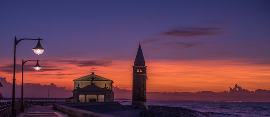 panorama of Caorle at sunset light of the street lamps lit. Size banner optimized Wall mural