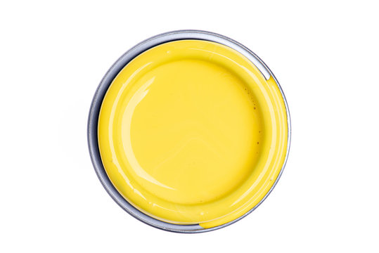 Can lid with yellow paint isolated on white background, top view