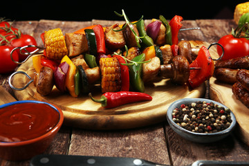 Assorted delicious grilled meat and skewer with vegetable on rustic table
