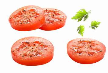 Tomatoes slices and parsley leaves on a white background isolated