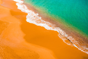 picture from a drone of colorful beach at portugal