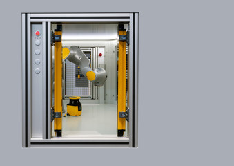 Robot display in metal cage, an industrial robotic arm