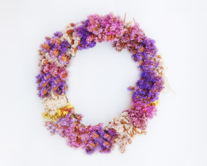 first of May handmade colorful flowers wreath, soft and airy blur on white background