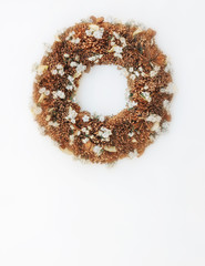 first of May traditional wreath made of twigs and small white flowers, soft and airy on white background