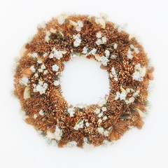 first of May traditional wreath made of twigs and small white flowers, soft and airy blur on white background