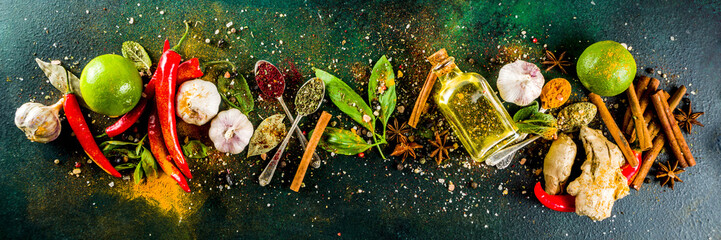 Various herbs and spices on dark background top view copy space