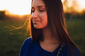 Portrait photo at sunset.Brunette close-up.Selective focus