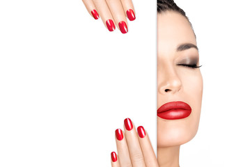Beauty Makeup Concept. Red Nail Art and Make-up. Half face with a white card template.